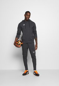 Under Armour - ACCELERATE OFF-PITCH JOGGER - Träningsbyxor - black - 1