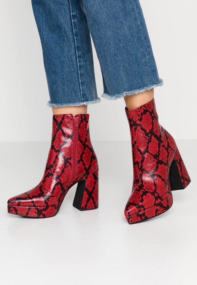 DORMANT - High heeled ankle boots - red