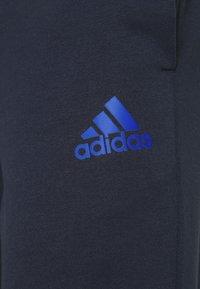 adidas Performance - DK ESSENTIALS - Tracksuit bottoms - legend ink/bold blue - 5