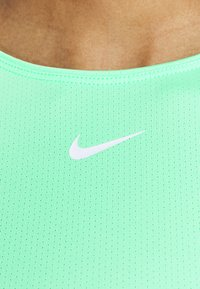 Nike Performance - ALL OVER - T-shirt - bas - green glow/white - 3
