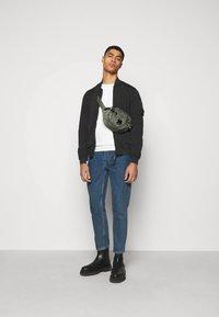 C.P. Company - OUTERWEAR SHORT JACKET - Summer jacket - black - 1