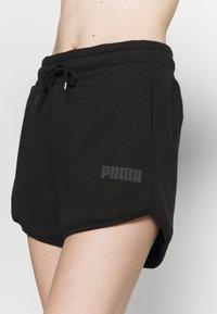 Puma - MODERN BASICS  - Pantalón corto de deporte - black - 4
