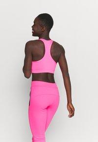 Ellesse - PRESELLE - Medium support sports bra - neon pink - 2