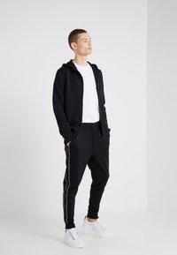 HUGO - DRAPANI - Pantalon de survêtement - black - 1