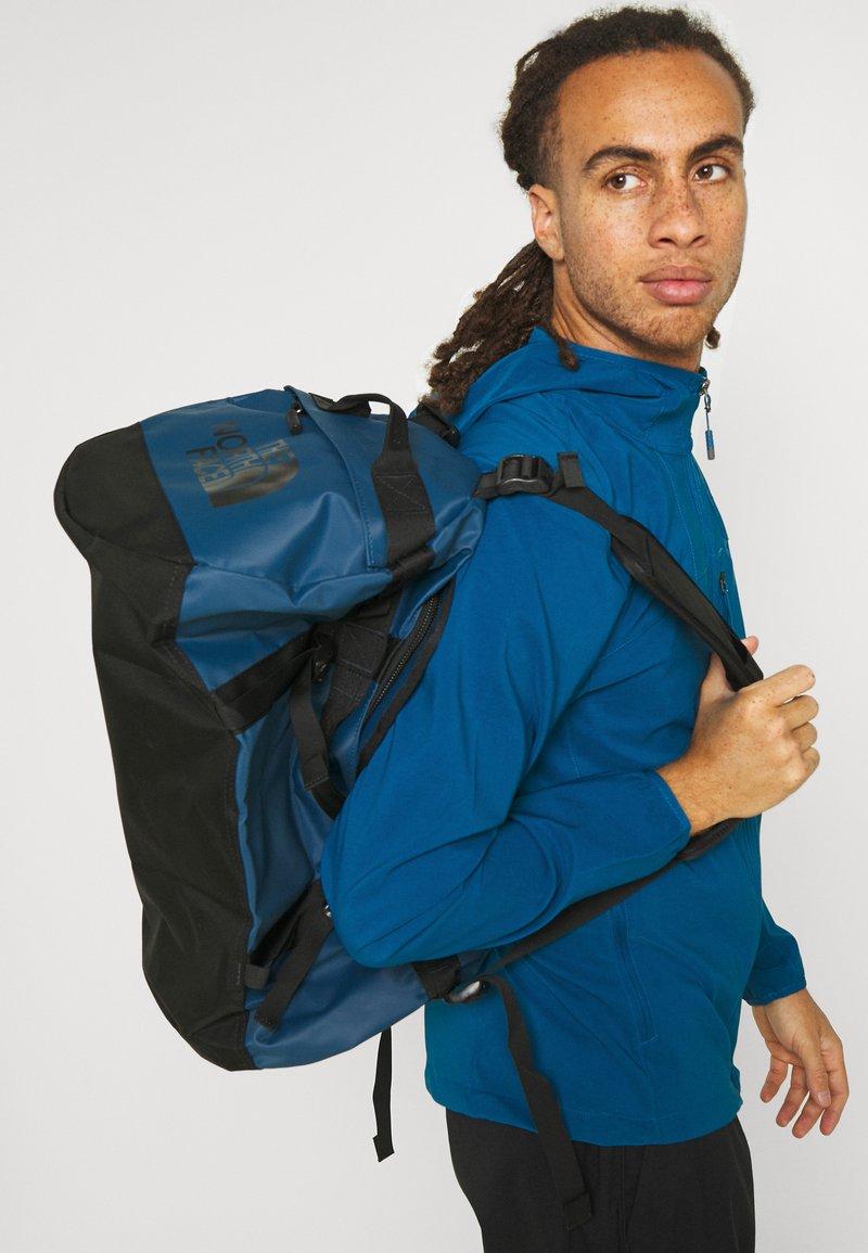 The North Face - BASE CAMP DUFFEL S UNISEX - Sports bag - monterey blue/black