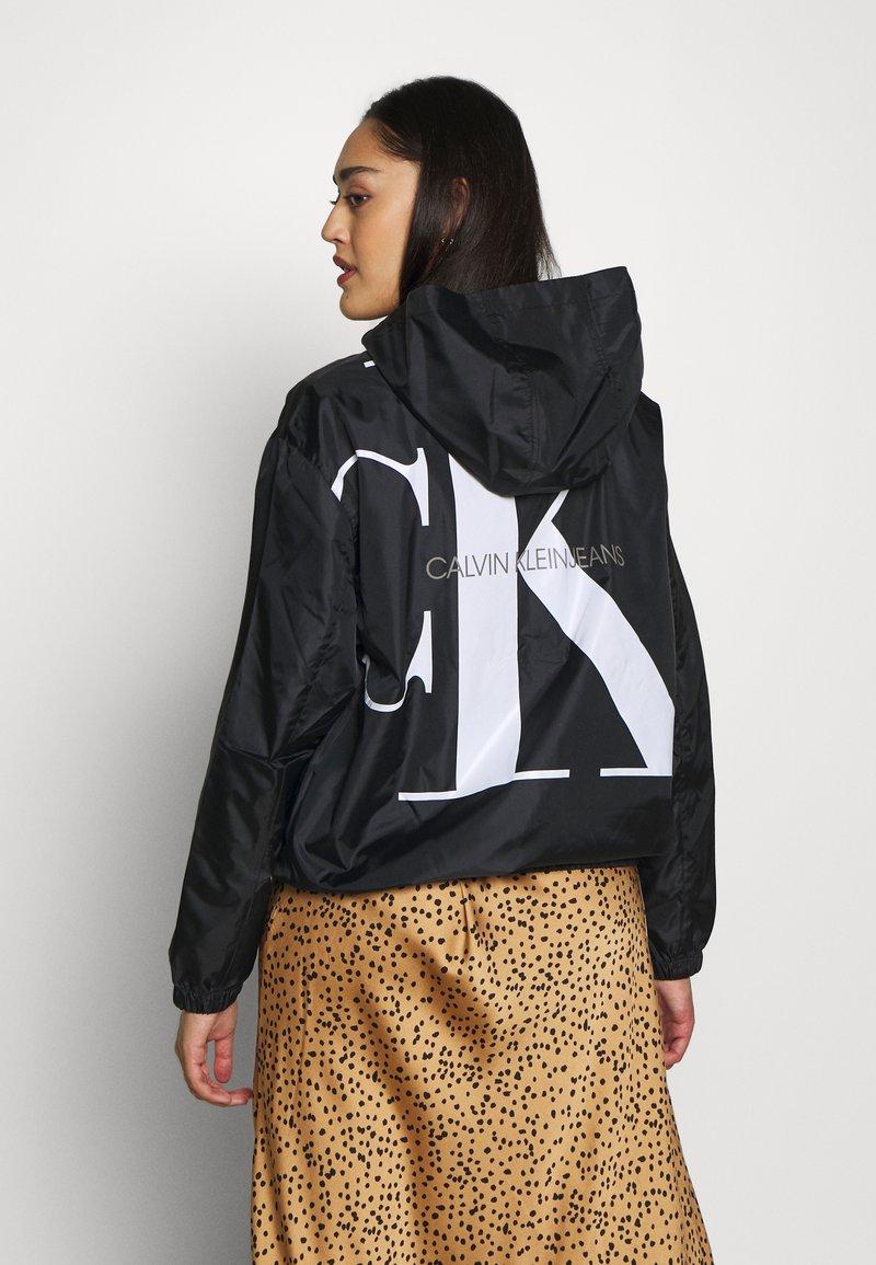Calvin Klein Jeans Plus - PLUS LARGE CK HOODED ZIP THROUGH - Training jacket - black