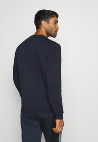 adidas Performance - ESSENTIALS SPORTS - Sweatshirts - dark blue