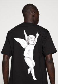 Fiorucci - TEE - Print T-shirt - black - 8