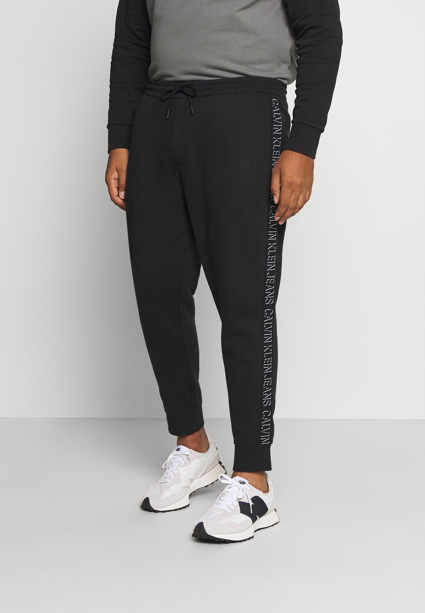 Homme SHADOW LOGO TAPE PANT - Pantalon de survêtement
