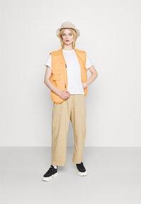 adidas Originals - Waistcoat - acid orange - 1