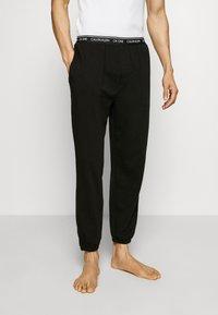 Calvin Klein Underwear - CK ONE JOGGER - Pantaloni del pigiama - black - 0