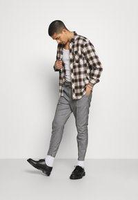 Kings Will Dream - RALPHI SMART JOGGERS - Trousers - grey check - 1