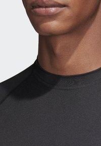 adidas Performance - Alphaskin Sport+ 3-Stripes TeALPHASKIN SPORT+ 3-STRIPES LONG-SLEEVE TOP - Sports shirt - black - 3