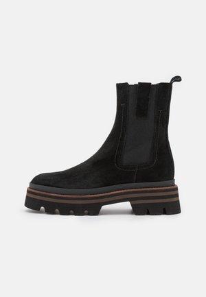 ASPEN - Platform ankle boots - black