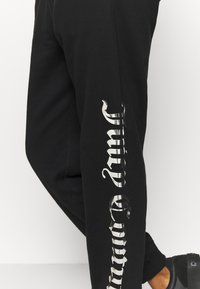 Juicy Couture - IVY - Tracksuit bottoms - black - 4