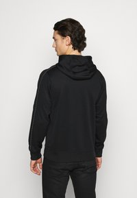 Nike Sportswear - REPEAT HOODIE - Long sleeved top - black/reflective silver - 2
