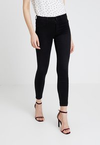 ONLY - ONLPEGGY PUSH UP ANKLE - Jeans Skinny Fit - black denim - 0