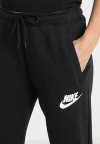 Nike Sportswear - RALLY  - Træningsbukser - black/white - 4