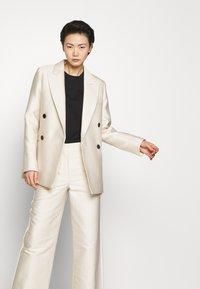 DESIGNERS REMIX - HAILEY FLARE - Trousers - cream - 4