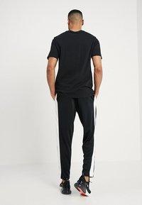 Nike Sportswear - AIR PANT - Træningsbukser - black/sail - 2
