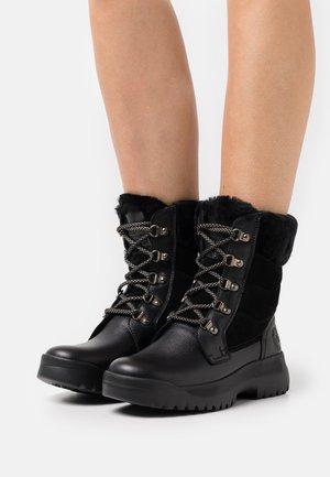 NYA IGLOO - Snowboots  - black