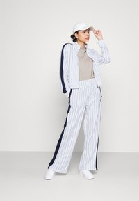 Fila - HALA TRACK JACKET - Summer jacket - blanc de blanc/black iris - 1