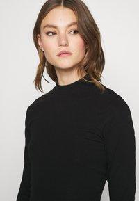Weekday - BEGONIA CUTOUT BACK DRESS - Jersey dress - black - 4
