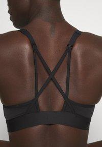 Reebok - LUX STRAPPY BRA - Light support sports bra - black - 3