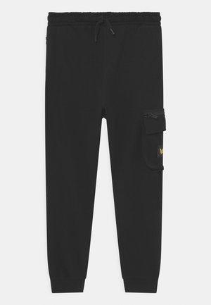 ZIP POCKET - Tracksuit bottoms - black