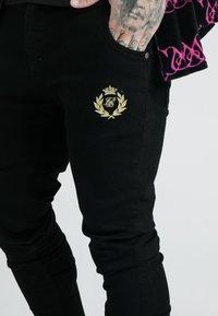 SIKSILK - X DANI ALVES PRESTIGE - Slim fit jeans - black - 4