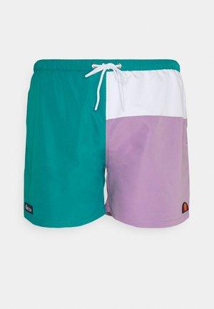 DEWI - Swimming shorts - dark green/lilac
