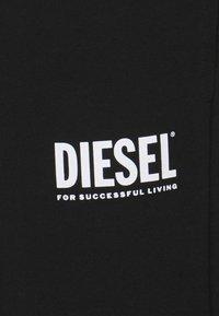 Diesel - TARY ECOLOGO - Tracksuit bottoms - black - 2