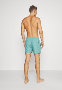 Rip Curl - VOLLEY - Swimming shorts - teal - 2