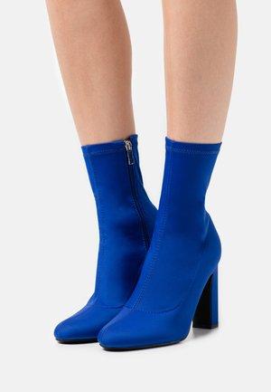 JEORGIA - Classic ankle boots - blue