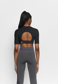 adidas by Stella McCartney - CROP - T-shirt basic - black - 2