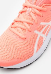 ASICS - PATRIOT 12 - Neutral running shoes - sun coral/white - 5