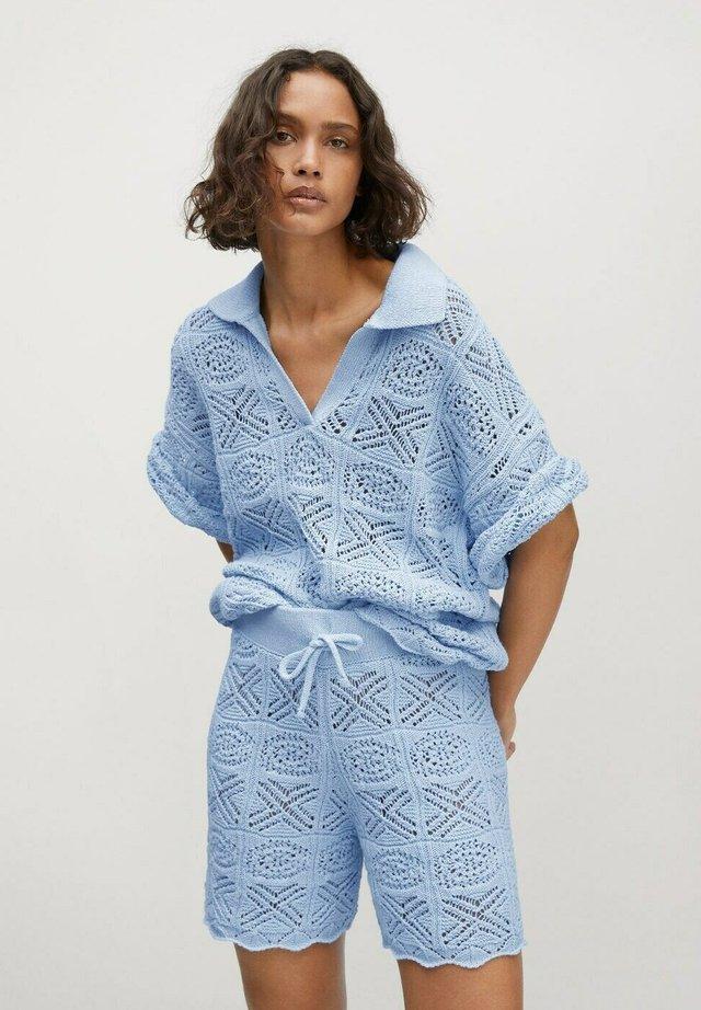 Stickad tröja - azul celeste