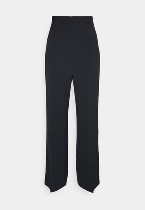 CRETA - Trousers - black