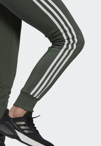 adidas Performance - ESSENTIALS FRENCH TERRY STRIPES PANTS - Tracksuit bottoms - greoxi/white - 4