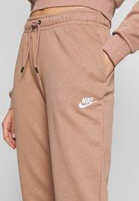 Nike Sportswear - Tracksuit bottoms - desert dust - 4