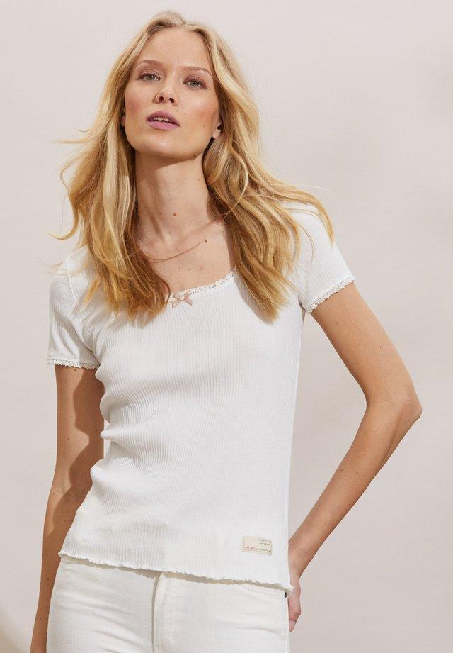 MAGDA - T-shirt con stampa - light chalk