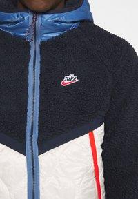 Nike Sportswear - WINTER - Veste d'hiver - obsidian/orewood/chile red - 5