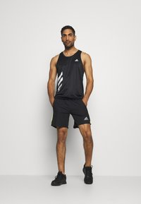 adidas Performance - OWN THE RUN - Sports shorts - black/signal green - 1