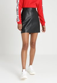 Vero Moda - VMYOURS BUTTER SHORT SKIRT - Mini skirts  - black - 0