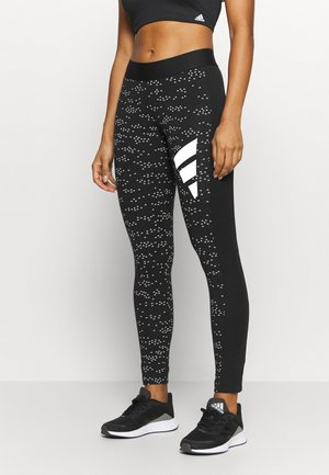 ADIDAS SPORTSWEAR ALLOVER PRINT LEGGINGS - Tights - black