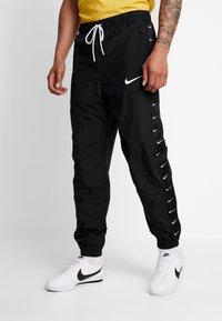 Nike Sportswear - PANT - Pantalones deportivos - black/white - 0