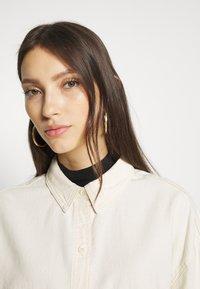 Monki - ALLISON - Button-down blouse - white light unique - 3