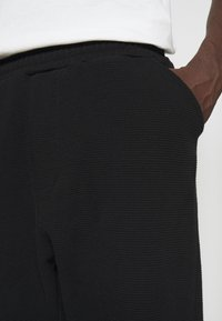 oftt - TROUSERS - Pantalon classique - black - 4