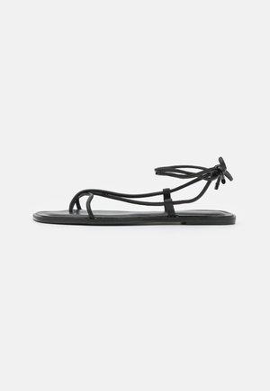 ADRAVIA - T-bar sandals - black
