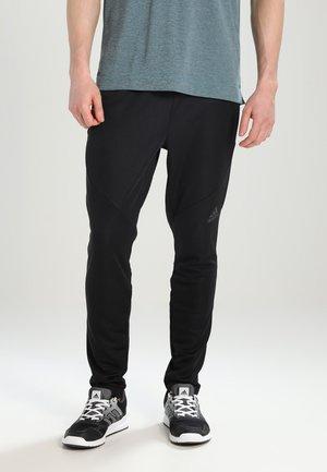 PANT CLITE - Tracksuit bottoms - black